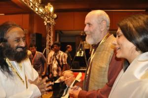With Sri Sri Ravi Shankar (left)